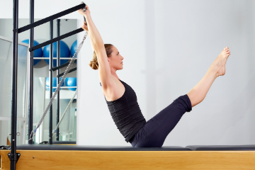 woman on reformer as part of pilates classes