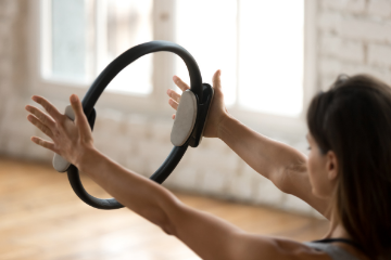 woman with circle as part of pilates classes